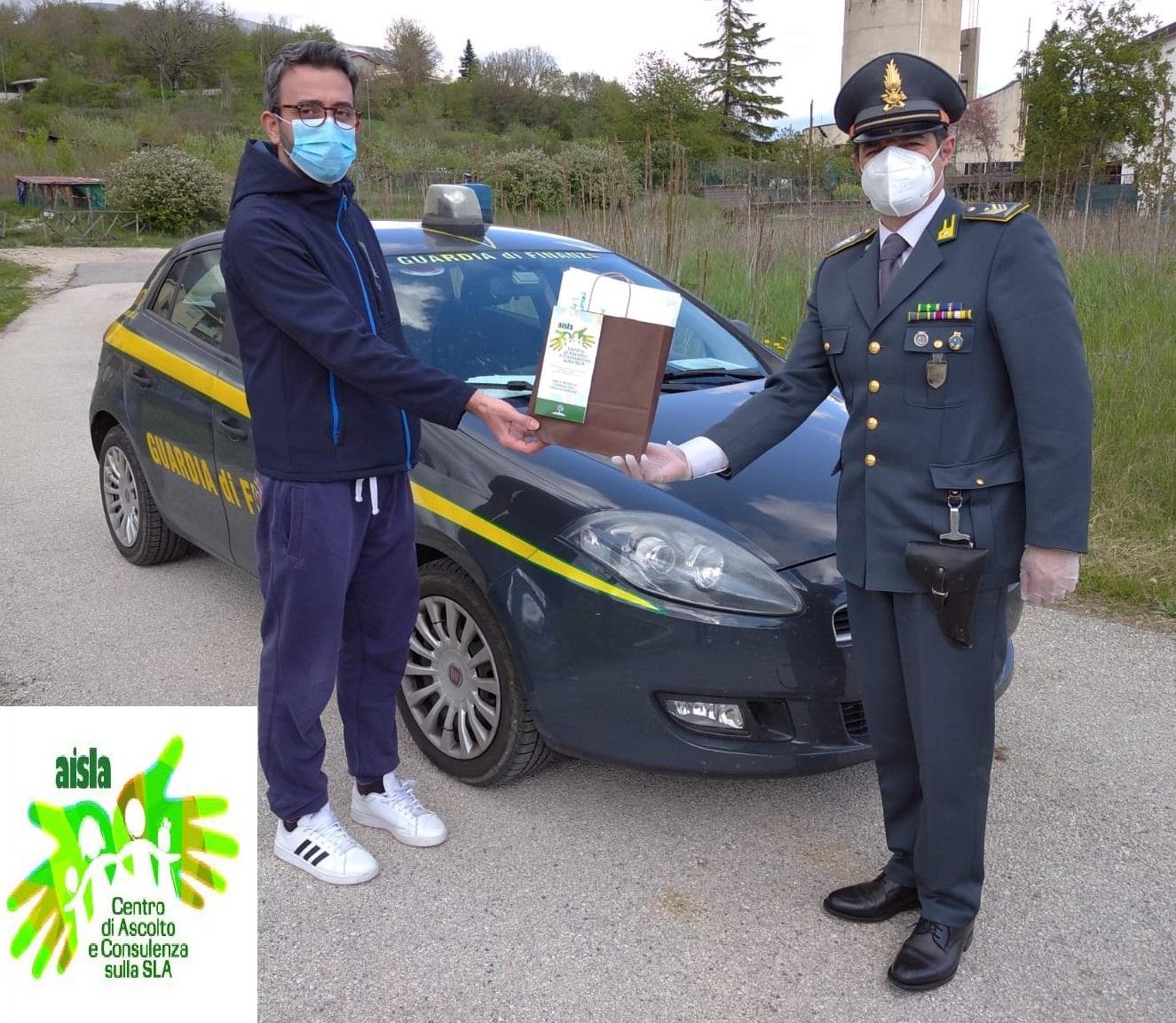 Emergenza Coronavirus, la Guardia di Finanza di L'Aquila consegna mascherine a persone con sindrome di SLA