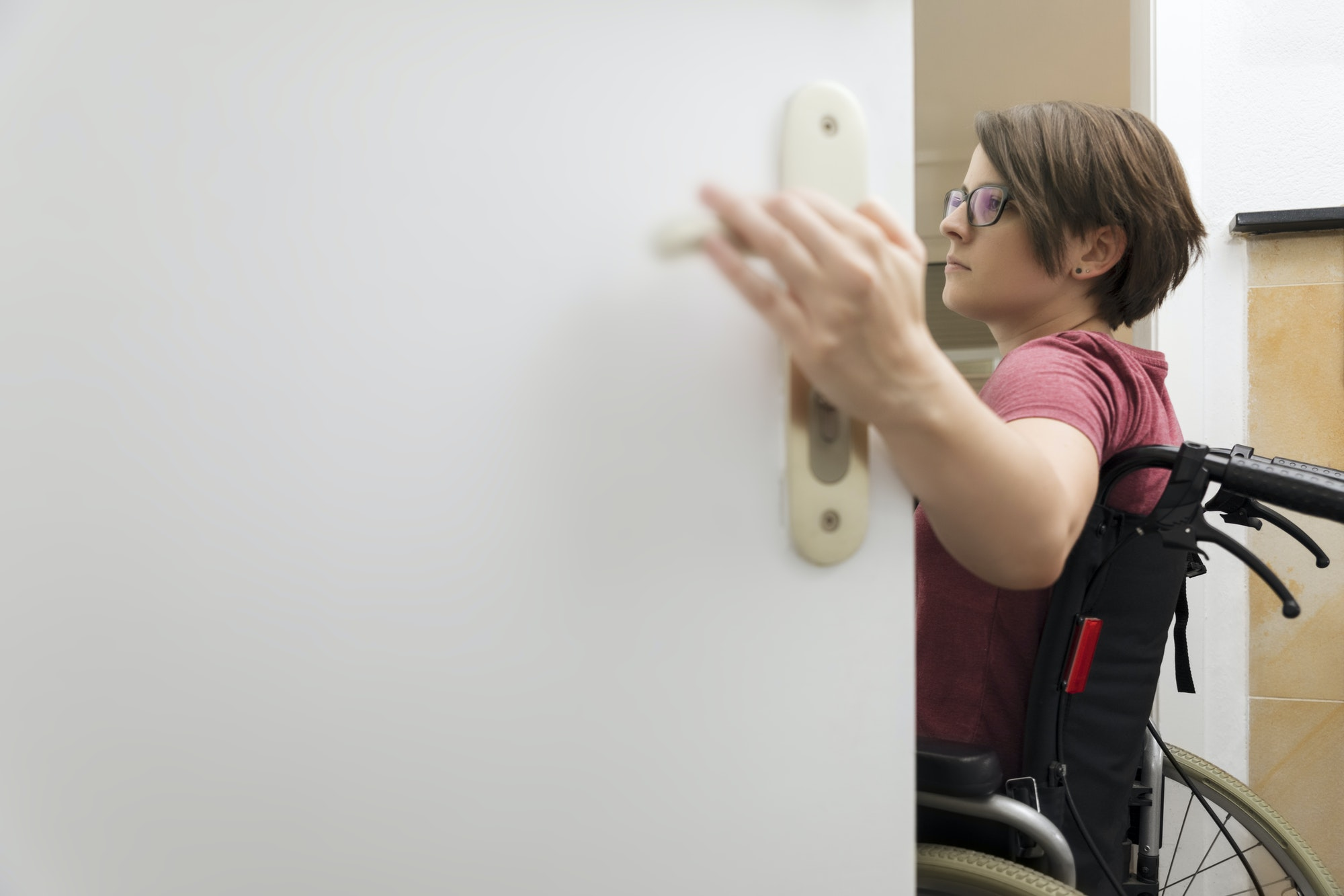 disabled woman at the open door with space for your content